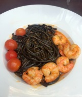 Spaghetti nero with shrimps and hot sauce.