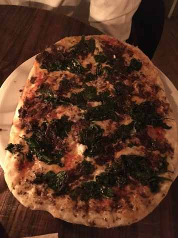Pizza with spinach, raisins, pine nuts and feta cheese at Lamucca de Pez.